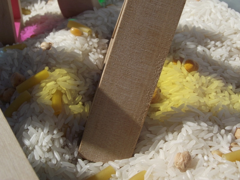 Simple toddler activity ideas to explore colour and texture through outdoor block play!