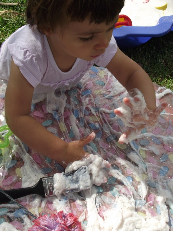 Follow this easy budget friendly recipe to make your own batch of soapy slime for sensory play. Safe for baby & toddler and a whole lot of messy fun!