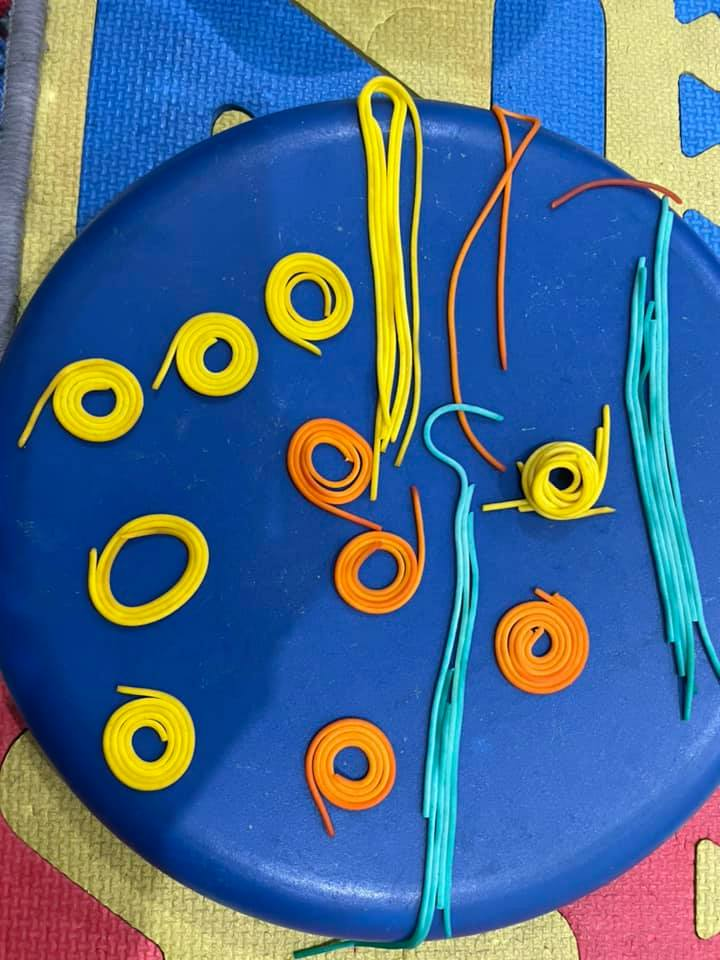 Coloured spaghetti artwork